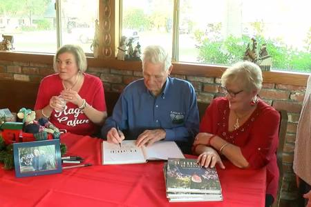 Local WWII vet celebrates 94th birthday, holds book signing for autobiography